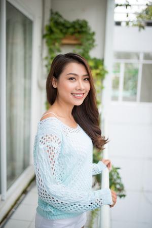 Asian woman enjoying fresh air at home