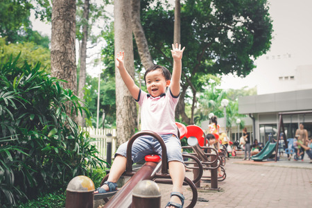Cute little asian boy in a park on a nice day outdoors Stock Photo