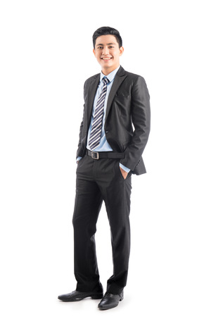Full length of handsome asian businessman isolated on white background Stock Photo