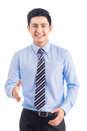 Happy smiling young asian man show thumb isolated on white background. Standard-Bild