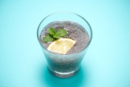 lemon balm: Selective focus of chia seeds drink with water in transparent glass with lemon balm.