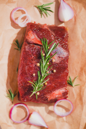 Raw beef on a cutting board  with spices and ingredients for cooking. Stock Photo - 79113185