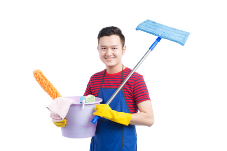 Man holding plastic bucket with brushes and detergents on white. Imagens