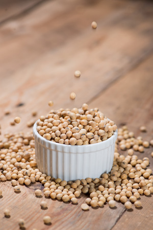 Soya beans or soybeans on wooden table.
