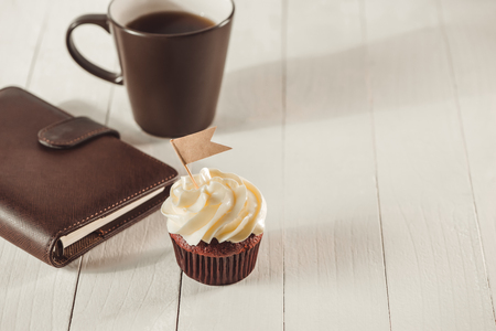 Fathers day concept. Delicious creative cupcake and cup of coffee on table. Stok Fotoğraf