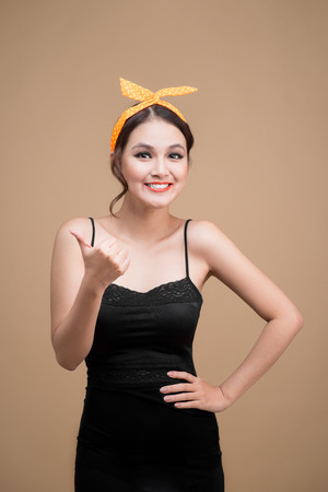 Beautiful woman pinup style portrait. Asian woman hands gesture Stock Photo