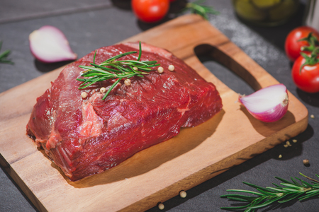 Raw beef on a cutting board  with spices and ingredients for cooking. Stock Photo - 80104753