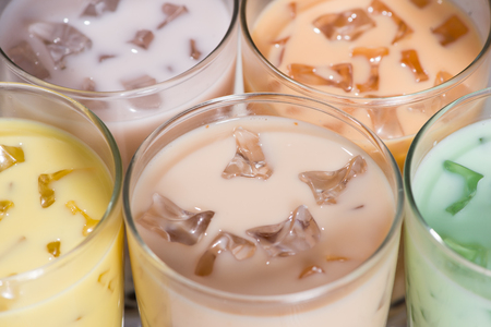 Bubble tea. Homemade Various Milk Tea with Pearls on wooden table. Stock Photo