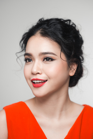 Fashion portrait of asian woman with elegant hairstyle. Perfect makeup. Stock Photo