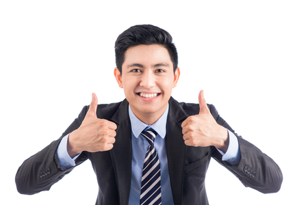 Young attractive asian businessman showing thumbs up