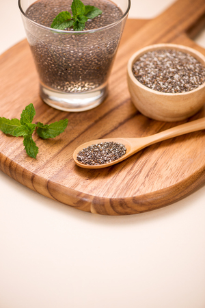 Selective focus of chia seeds drink with water in transparent glass. Stock Photo
