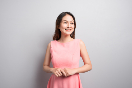 Smiling business woman in pink dress. Isolated portrait.