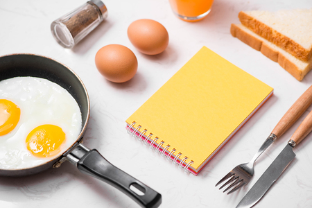 Top view of traditional healthy easy quick breakfast meal made of fried eggs served on a frying pan. Фото со стока