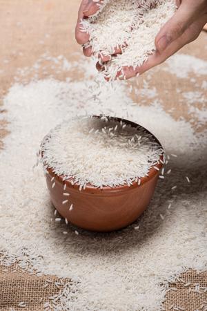 Rice in spoon and bowl. Jasmine Rice, Thai Rice, White Rice. Stock Photo