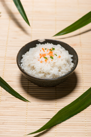 Boiled rice in a bowl on wooden table. Stock Photo