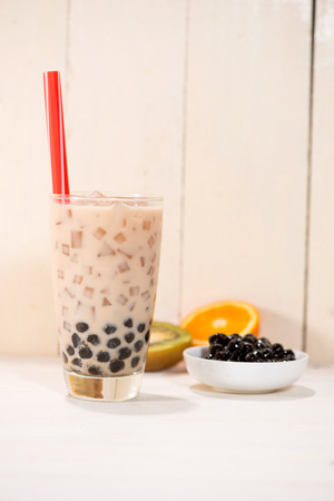 Boba  Bubble tea. Homemade Milk Tea with Pearls on wooden table. Reklamní fotografie