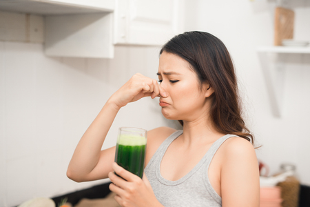 Young asian woman enjoy healthy vegetarian smoothie for weight loss and detox Stock Photo