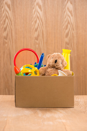Toy. Donation box with  unwanted items for poor Stock Photo