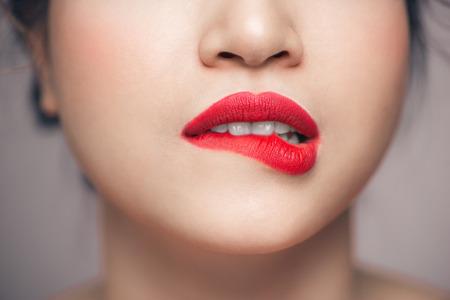 Red Sexy Lips closeup. Make up concept. Beautiful Perfect Lips. Standard-Bild