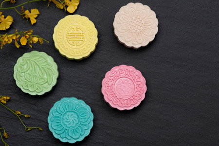 Sweet color of snow skin mooncake on dark background.