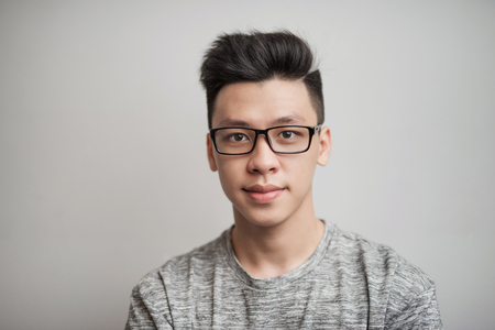 Portrait of good looking asian man in glasses