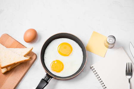 Top view of traditional healthy easy quick breakfast meal made of fried eggs served on a frying pan. Stok Fotoğraf
