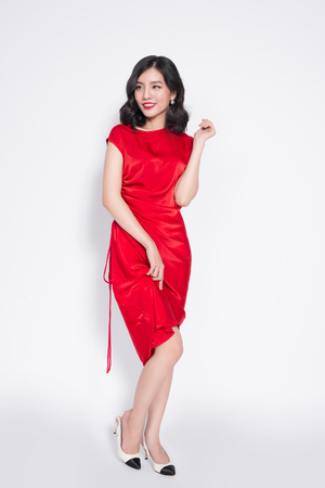 Full length of amazing luxury asian woman in stylish red party dress