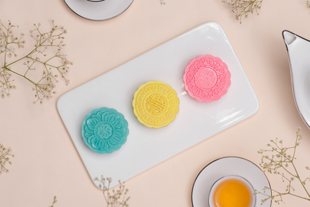 Sweet color of snow skin mooncake. Traditional mid autumn festival foods with tea on table setting. Stok Fotoğraf