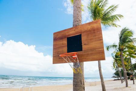 Basketball backboard on sunny sky blue day on the tropical beach Stock Photo