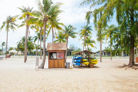 Life guard house on tropical beach with palm trees, blue sky and white sand. Reklamní fotografie