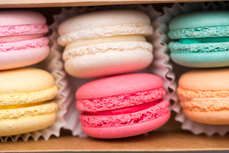 Sweet macarons. Different french cookies macaroons in a paper box. Stock fotó