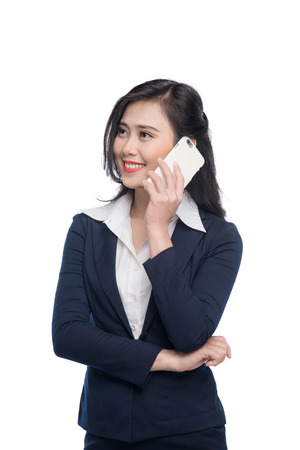 Asian businesswoman listening to smartphone isolated on white.