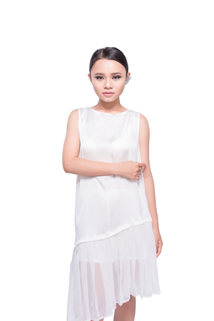 Beautiful expressive asian model girl in white design dress. Isolated on white.
