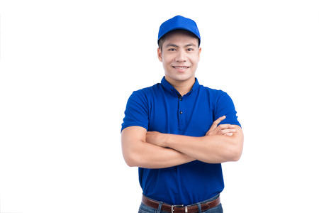 Asian Man in Blue Uniform. White Background. Imagens