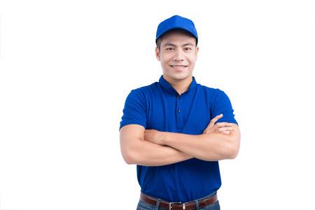 Asian Man in Blue Uniform. White Background. Foto de archivo