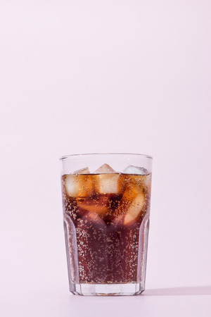 Cola and ice cubes in a glass Stok Fotoğraf