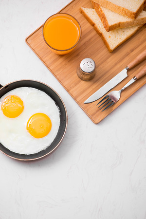 Traditional breakfast with fried eggs on a plate Stock Photo