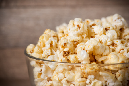 Popcorn in bowl on the wooden table, selective focus Stok Fotoğraf