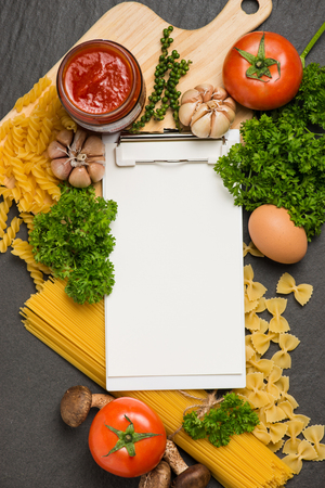 Italian spaghetti photo recipe. Stationary mockup on the kitchen table surrounded with products.