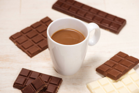 Glass of chocolate milk and variety chocolates  on table Stock Photo - 82064013