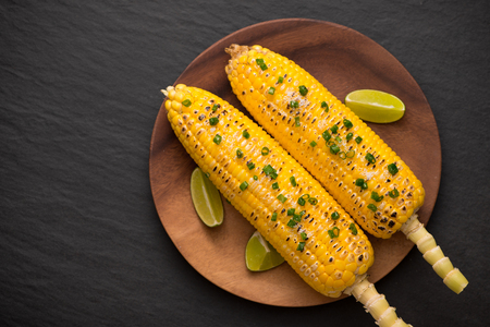 Tasty sweet grilled corn with onion sauce Stock fotó