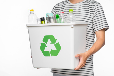 Eco concept. Male hands holding recycling bin full of recyclable items isolated on a white background. 版權商用圖片