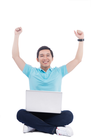 Portrait of young asian student holding laptop