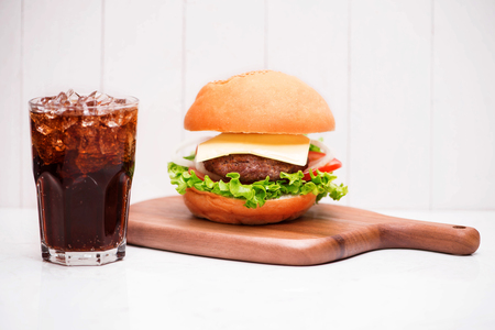 Homemade BBQ burger with coke on wooden background. Stok Fotoğraf