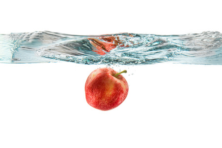 Red apple dropped into the water with water splash on a white background