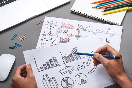 Business concept. Businessman writing idea sketch Stock Photo