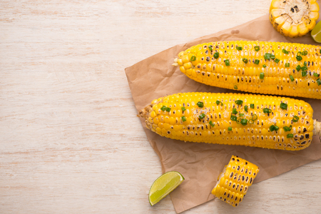 Tasty sweet grilled corn with onion sauce Stock Photo