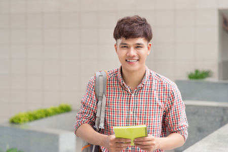 Young asian student inside university building