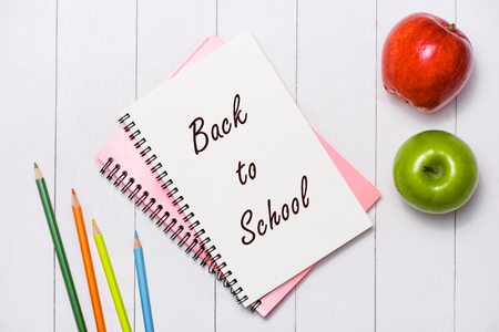 School stationery or office supplies on wood background.
