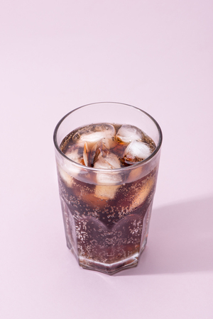 Cola and ice cubes in a glass Stock Photo
